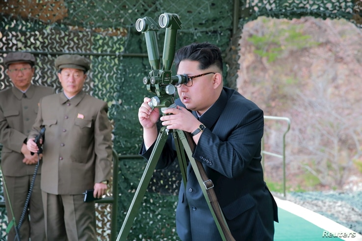 A photo shows North Korean leader Kim Jong Un focusing on the underwater test-fire of a strategic submarine ballistic missile in this undated photo released by North Korea's Korean Central News Agency (KCNA) in Pyongyang, April 24, 2016.