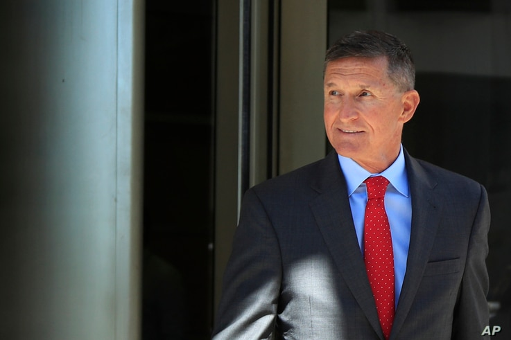 Former Trump national security adviser Michael Flynn leaves federal courthouse in Washington, July 10, 2018, following a status hearing.