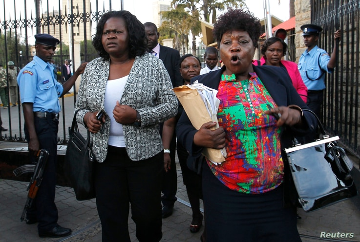 Kenyan members of parliament Gladys Wanga, left, and Christine Mbaya leave the National Assembly to protest against the approval of new anti-terrorism laws in Kenya's capital Nairobi, Dec. 18, 2014.