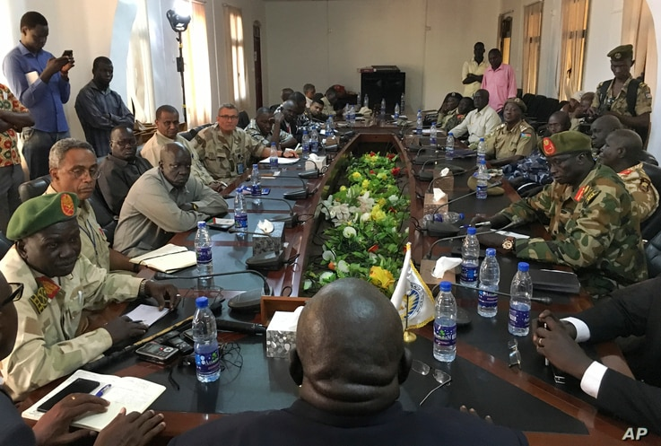 FILE - In this photo taken Nov. 22, 2018, a South Sudan armed opposition commander, Ashab Khamis, far left, and government army Gen. Keer Kiir Keer, far right, attend talks where both sides exchanged accusations of violating the peace agreement, in W...
