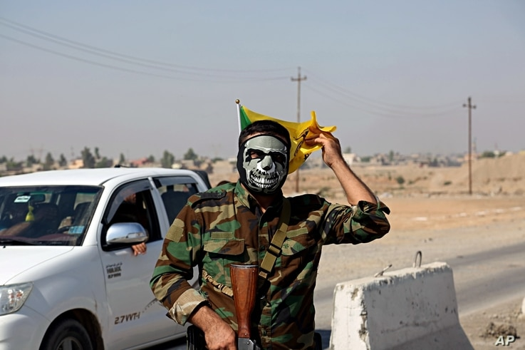 IA fighter with Popular Mobilization Forces stands guard in Tuz Khormato, 130 miles (210 kilometers) north of Baghdad, Iraq, Oct. 16, 2017.