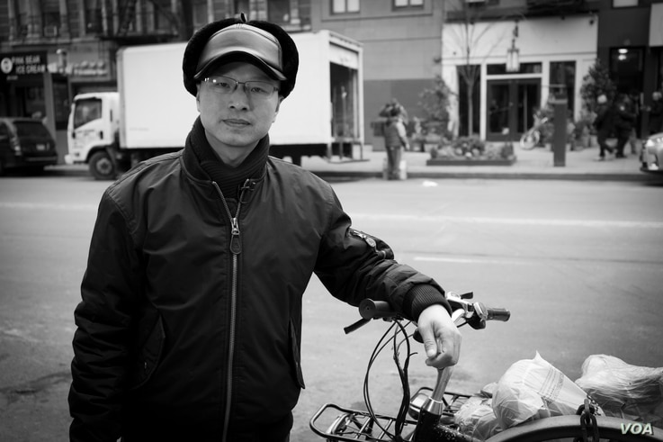 """Liqiang Liu, 45, feels it is his responsibility to stand up for older e-bike delivery workers, many of whom work more than 60 hours per week to earn a livable salary. """"We can't take a day off even we are sick,"""" he tells VOA."""
