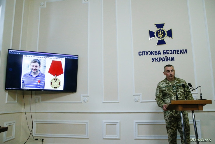 A photo of the director of the Kyiv office of Russian state news agency RIA Novosti Kirill Vyshinsky is seen on a monitor during a news briefing at the headquarters of the Ukraine's state security service (SBU) in Kyiv, Ukraine, May 15, 2018.