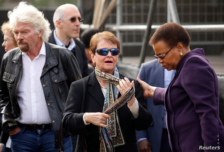 Gro Harlem Brundtland, Norway's former Prime Minister, joins Richard Branson and Graca Machel, widow of former President Nelson Mandela, on a walk to commemorate what would have been Mandela's 99th birthday in Cape Town, South Africa, July 18, 2017. ...