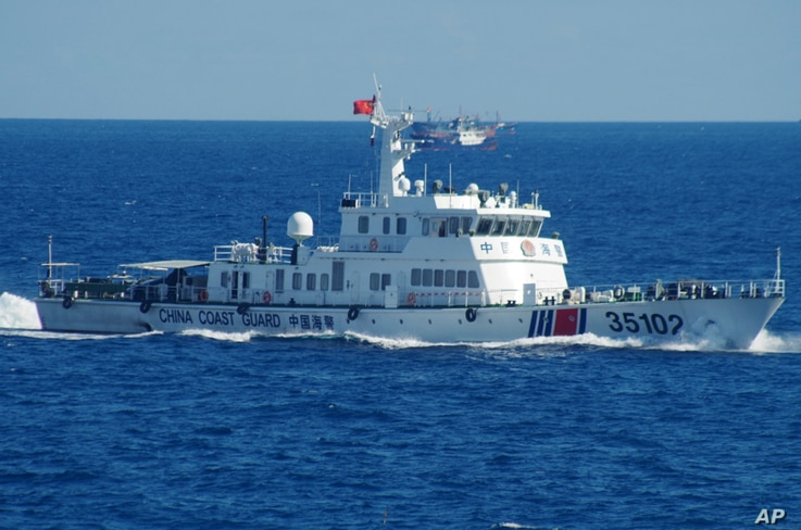 In this photo released by the 11th Regional Coast Guard Headquarters of Japan, a Chinese coast guard vessel sails near disputed East China Sea islands, Aug. 6, 2016.