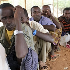 Newly arrived Somali refugees queue for relief food at the Dadaab refugee camp, near the Kenya-Somalia, July 23, 2011