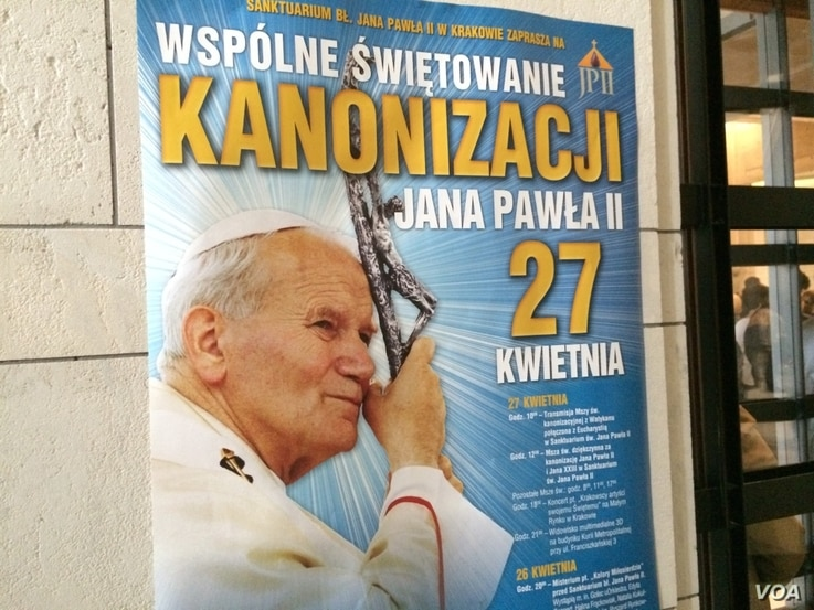 """Posters all around town say """"Communal Celebration of the canonization of John Paul II, April 27,"""" Cracow, Poland, April 22, 2014. (Jerome Socolovsky/VOA)"""
