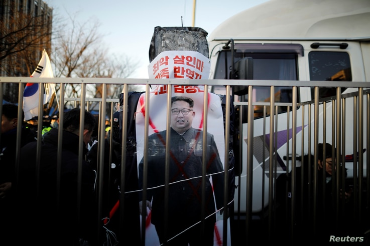 A banner with the image of North Korean leader Kim Jong Un is seen as members of a South Korean conservative civic group take part in an anti-North Korea protest in Seoul, South Korea, Dec. 8, 2018.