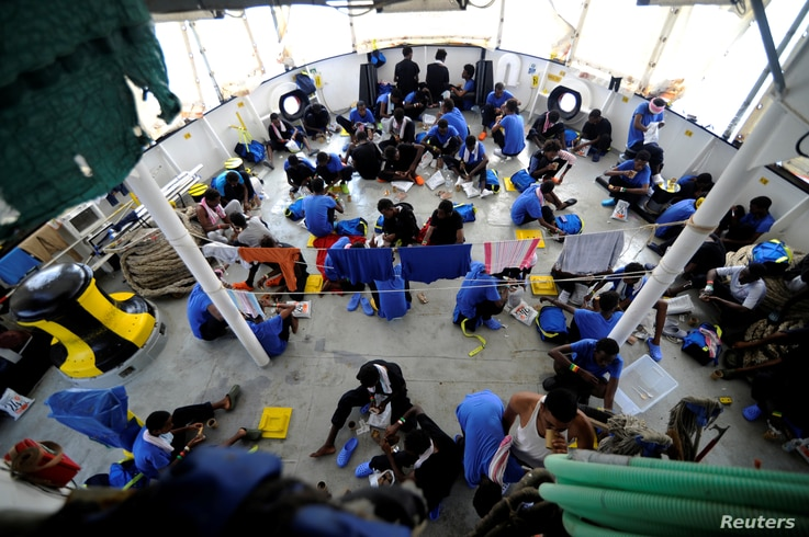 Migrants are seen on board the MV Aquarius, in the Mediterranean Sea, between Malta and Linosa, Aug. 14, 2018.