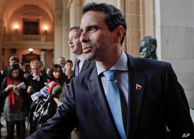 Venezuelan opposition leader Henrique Capriles arrives to speak to members of the media following his meeting with Organization of America States (OAS) Secretary General Luis Almagro, at the OAS building in Washington, March 31, 2017.