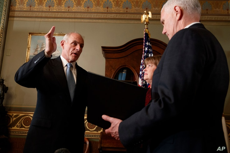 Vice President Mike Pence administers the oath of office to Homeland Security Secretary John Kelly in the Vice Presidential Ceremonial Office in the Eisenhower Executive Office building on the White House grounds in Washington, Jan. 20, 2017.