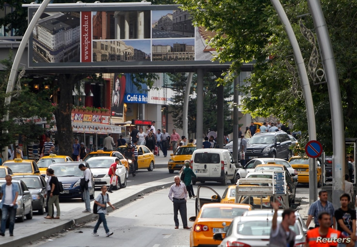 FILE - Taxi drivers wait for costumers in Kizilay Square, in Ankara, Turkey, June 17, 2013.