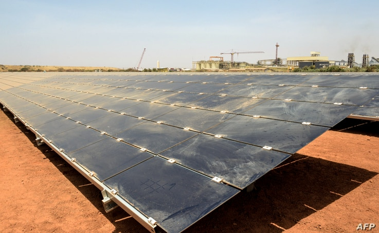 FILE - Solar panels are pictured at the new 15 MWp photovoltaic (PV) power plant supplying the Canadian mining company Iamgold's Essakane gold mine on its inauguration on March 16, 2018 near Dori in northern Burkina Faso.