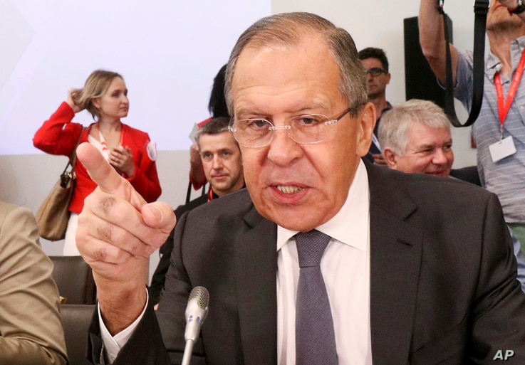 Russian Foreign Minister Sergey Lavrov talks to journalists before an informal ministerial meeting of the Organization for Security and Cooperation in Europe, OSCE, in Mauerbach near Vienna, Austria, July 11, 2017.