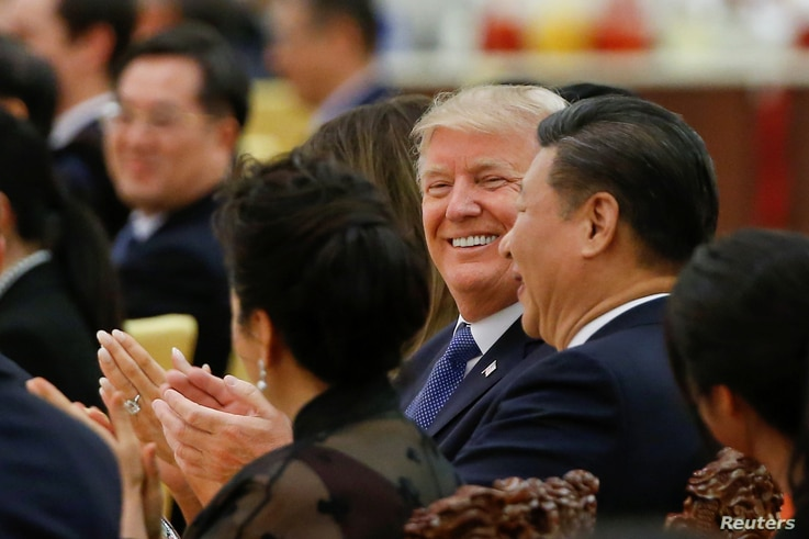 U.S. President Donald Trump and China's President Xi Jinping attend a state dinner at the Great Hall of the People in Beijing, Nov. 9, 2017.