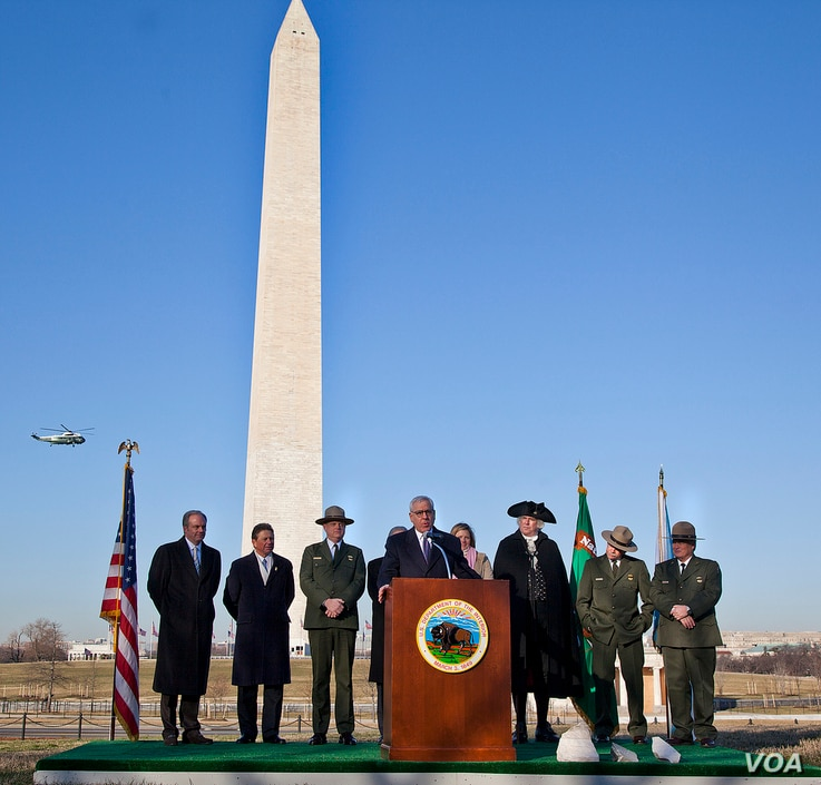 Philanthropist David Rubenstein speaks at the reopening of the Washington Monument in 2014, after it was damaged in an earthquake. (Credit: National Park Service)