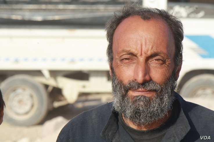 Abd Hassan Shaban, a 50-year-old father of seven, a week after fleeing his home in Raqqa, is seen in Ain Issa camp, Syria, Oct. 23, 2017.(VOA/H. Murdock)