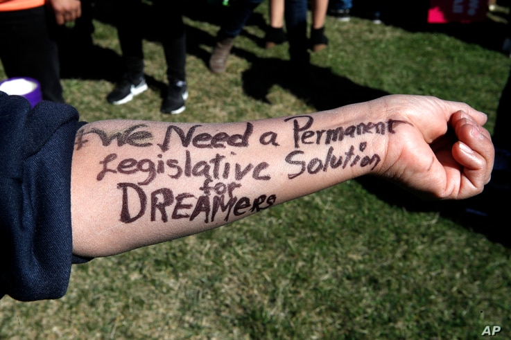 """Ivon Meneses of Las Vegas wrote """"We need a permanent legislative solution for Dreamers"""" on her arm as she and other supporters of the Deferred Action for Childhood Arrivals program attended an action in support of DACA recipients, March 5, 2018, on C..."""