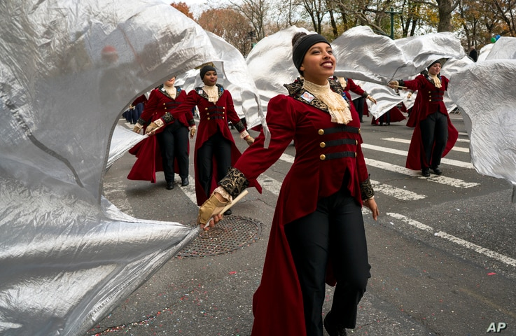 Members of the Hendrickson High School band from Pflugerville, Texas, march on Central Park West during the Macy's Thanksgiving Day Parade in New York, Nov. 24, 2016.
