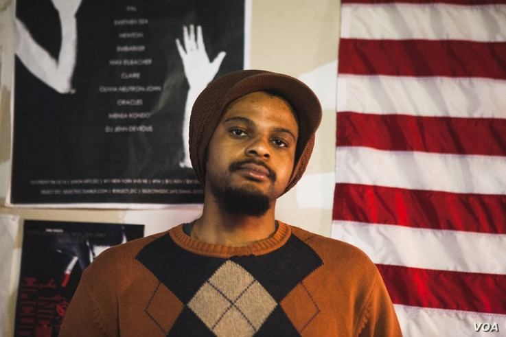 """Musician and co-founder of Union Arts D.C. Luke Stewart is at the front of the community movement to """"Save Union Arts"""" and preserve low-cost studio space for young artists and musicians, April 3, 2016. (A. Hernandez/VOA)"""
