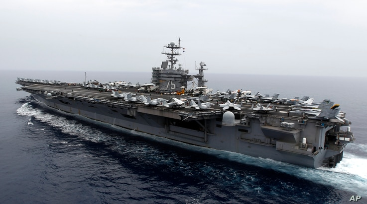 FILE - A general view  shows the nuclear-powered aircraft carrier USS Harry S. Truman at an undisclosed position in the Mediterranean Sea.