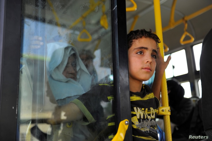 Civilians ride a bus to be evacuated from the besieged Damascus suburb of Daraya, after an agreement reached on Thursday between rebels and Syria's army, Syria, August 26, 2016.
