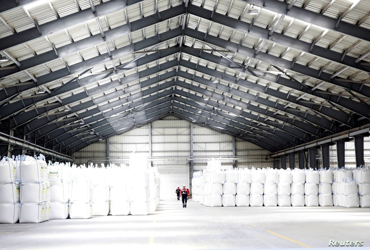 FILE - A storage unit is seen at an industrial plant in Llipi on the salt lake of Uyuni, Potosi, Bolivia, Oct. 7, 2018.