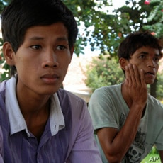 Buot Panha, left, who jumped off the bridge to safety, and his friend Ra, right, both of whom survived the stampede.