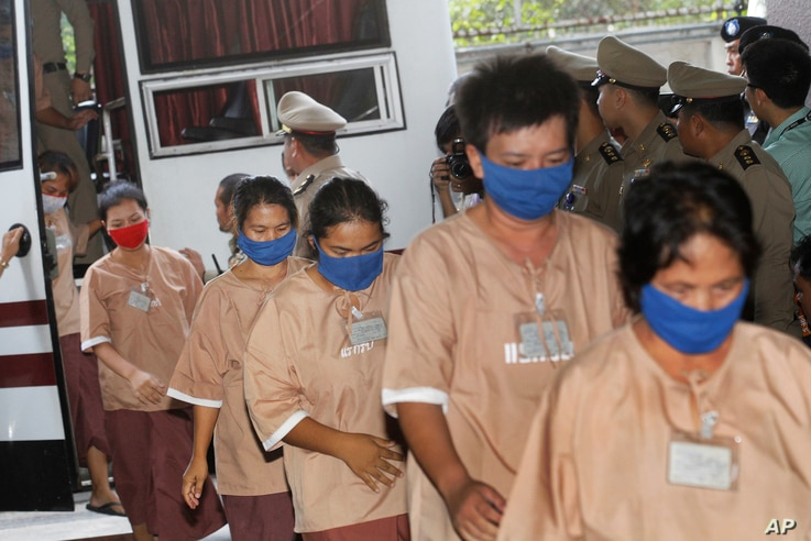 Female suspects allegedly involved in human trafficking of Rohingya migrants file into the Criminal Court in Bangkok, Thailand, Nov. 10, 2015.