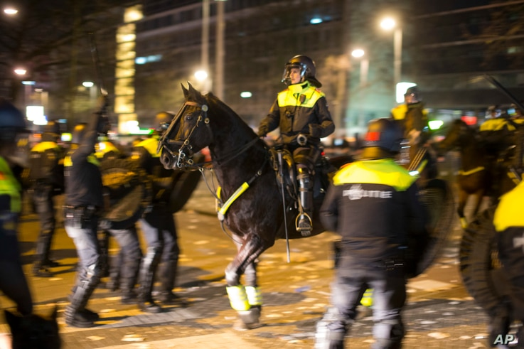 Dutch riot police battle pro Erdogan demonstrators after riots broke out at the Turkish consulate in Rotterdam, Netherlands, March 12, 2017.