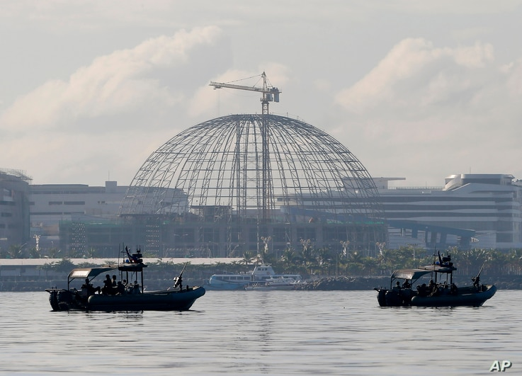 Patrol boats of the Philippine Navy Special Operations Group are positioned near the venue as they implement a no-sail zone policy at the restricted zone for next week's APEC (Asia-Pacific Economic Cooperation) Summit of Leaders Friday, Nov. 13, 2015...