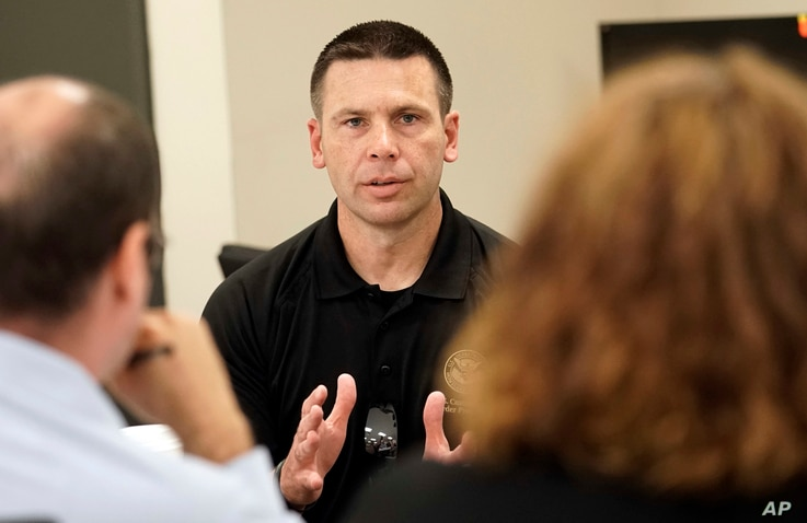 Kevin McAleenan, commissioner of U.S. Customs and Border Protection, talks with reporters at the U.S. Border Patrol Central Processing Center, Monday, June 25, 2018, in McAllen, Texas.