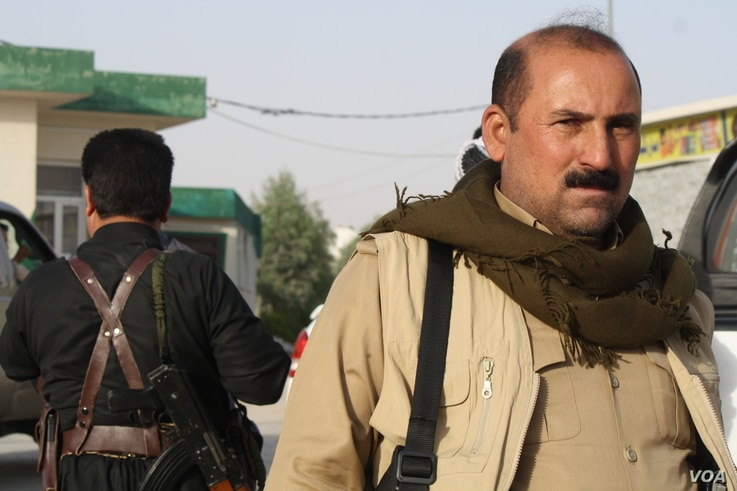 As civilian volunteers wait for their convoy to Kirkuk, Peshmerga fighters returning from battle say they were losing ground because forces under the control of Baghdad have better weapons on Oct. 16, 2017 north of Kirkuk, in the Kurdistan Region of ...