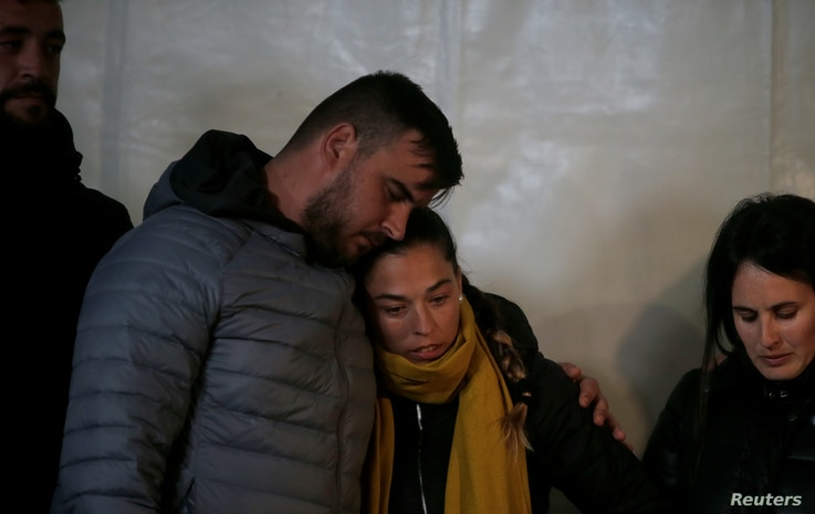 Julen's parents embrace during a vigil as a rescue team descends into a drilled well at the area where Julen, a Spanish two-year-old boy, fell into a deep well 11 days ago when the family was taking a stroll through a private estate, in Totalan, sout...