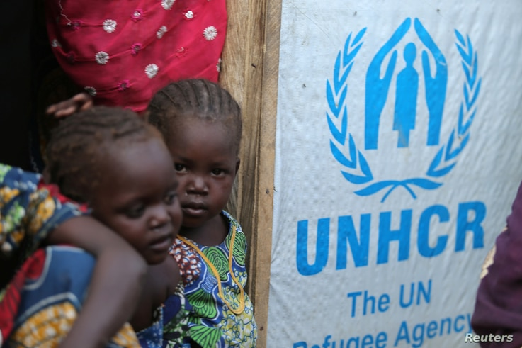 Children stand at the door of their house at a camp for internally displaced people in Maiduguri, Nigeria Nov. 29, 2016.