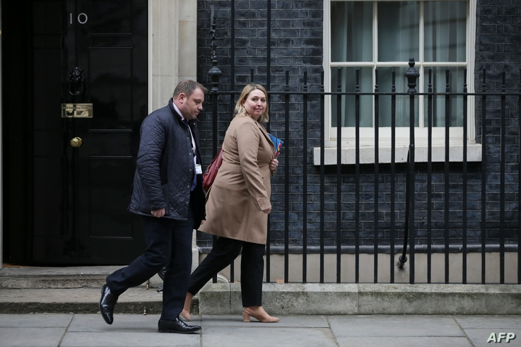 Britain's Northern Ireland Secretary Karen Bradley (R) leaves 10 Downing Street after attending a Brexit sub-committee meeting in central London, Feb. 8, 2018.