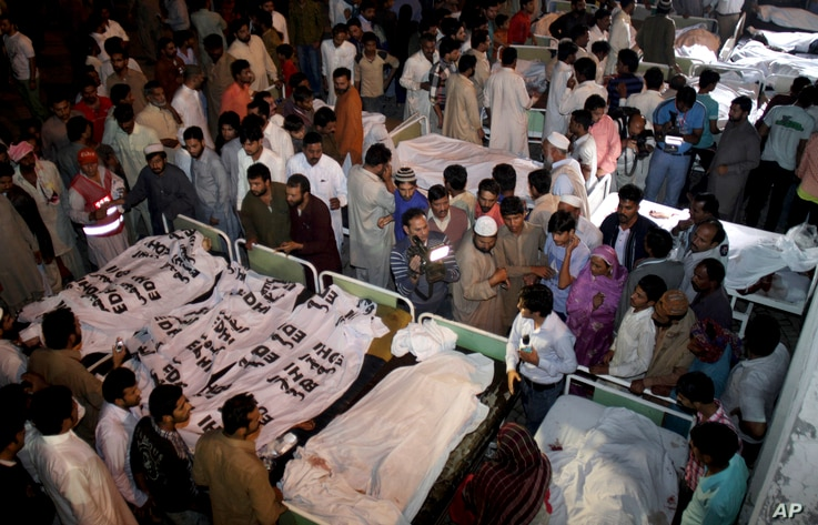 Pakistanis gather to identify bodies of their relatives killed in a bomb blast at a local hospital in Lahore, Pakistan, Nov. 2, 2014.