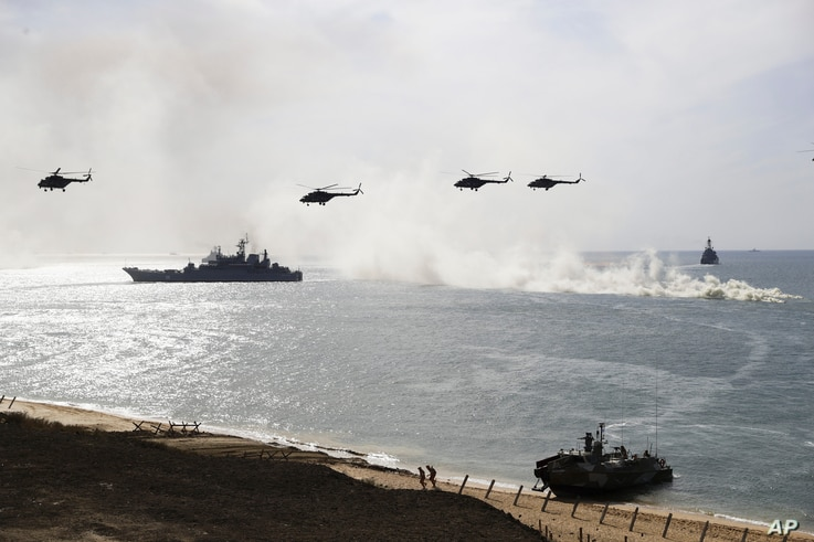 Russian navy ships and helicopters take a part in a landing operation during military drills at the Black Sea coast, Crimea, Sept. 9, 2016. The Russian military says major war games, the Zapad (West) 2017 maneuvers, set for next month will not threat...