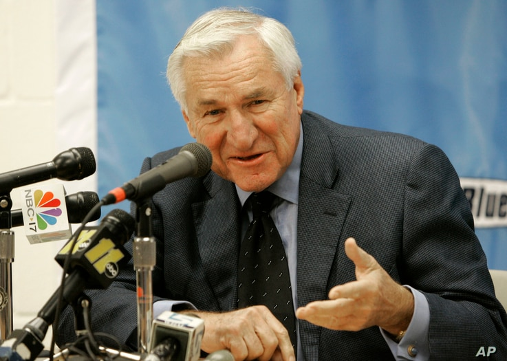 FILE - This Dec. 8, 2006 file photo shows former North Carolina basketball coach Dean Smith speaking during a news conference in Chapel Hill.