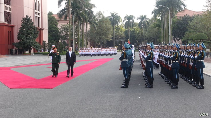 U.S. Secretary of Def Jim Mattis, alongside Vietnamese defense minister Ngo Xuan Lich, reviews rows of soldiers in front of Hanoi's defense ministry, Jan. 25, 2018.
