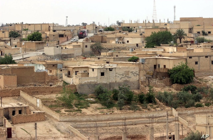 This April 30, 2017 photo provided by the Syrian Democratic Forces, shows a general view of the northern town of Tabqa, Syria.