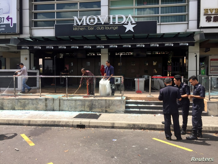 FILE - The Movida bar is pictured after a grenade attack in Puchong, on the outskirts of Kuala Lumpur, Malaysia, June 28, 2016.