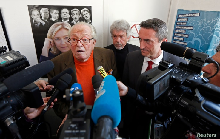 FILE - France's far-right National Front political party founder Jean-Marie Le Pen speaks to journalists at a news conference in Marseille March 27, 2014.