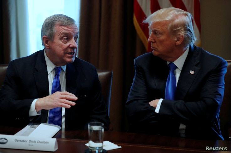 FILE - U.S. President Donald Trump, right, listens as U.S. Senator Dick Durbin, D-IL, speaks during a bipartisan meeting with legislators on immigration reform at the White House in Washington, Jan. 9, 2018. In a follow-up bipartisan meeting January ...