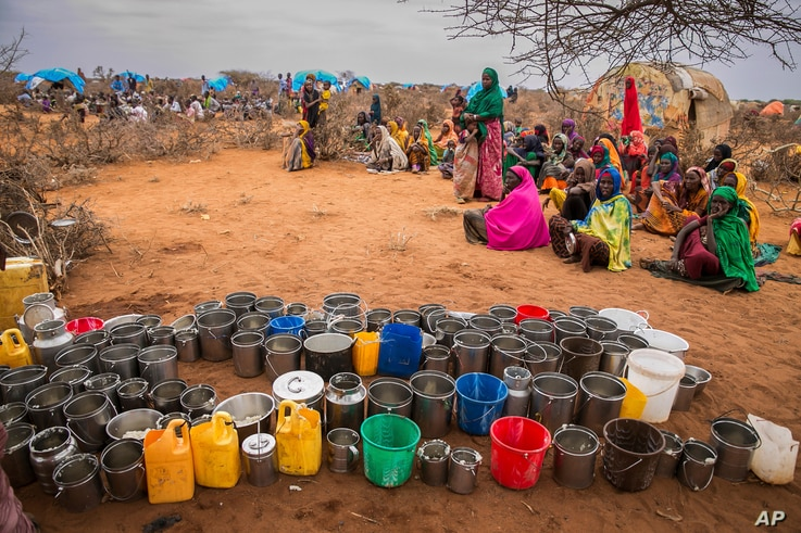 FILE - People wait for food and water in the Warder district in the Somali region of Ethiopia, Jan. 28, 2017.