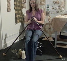 Jamie Galloway uses giant knitting needles to make items made of cotton free of pesticides and chemicals.