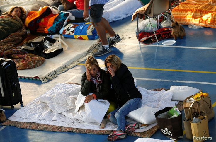 People rest following an earthquake in Amatrice, central Italy, Aug. 25, 2016.