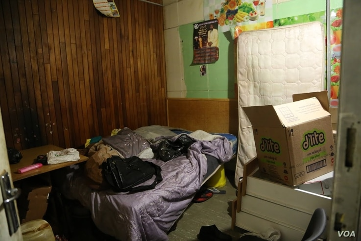 A bedroom for several people who have sought refuge at the church, Johannesburg, South Africa, May 8, 2015. (Gillian Parker/VOA)
