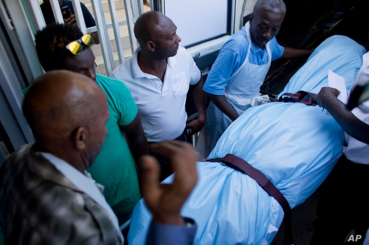 The body of Haiti's late former President Rene Preval arrives to the Sainte Claire hospital in Petion-Ville, Haiti, March 3, 2017.