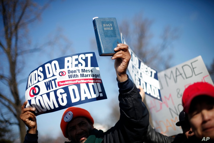 A demonstrator holds a bible while marching outside the Supreme Court in Washington, March 26, 2013.